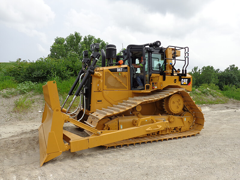 Picture of a medium sized bulldozer used by Champ Landfill in their daily operation.
