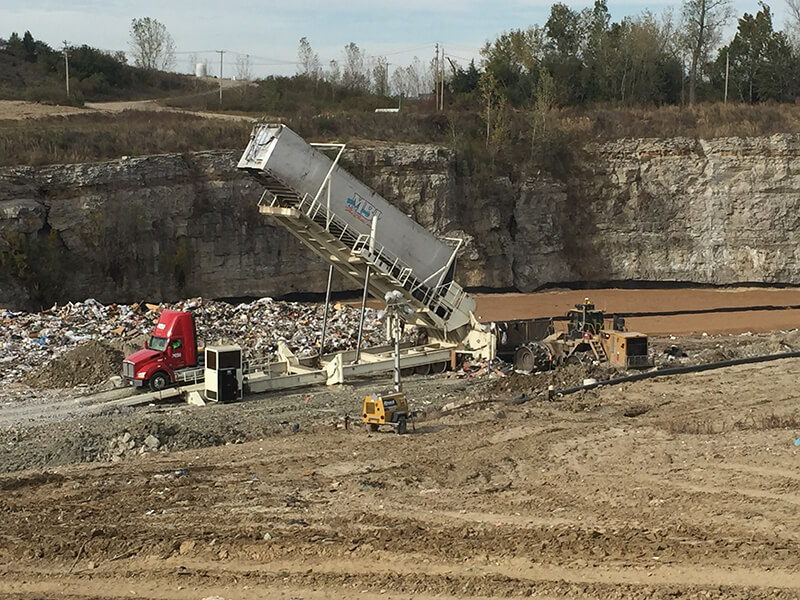 Picture of a Champ Landfill Tipper emptying waste into the landfill.