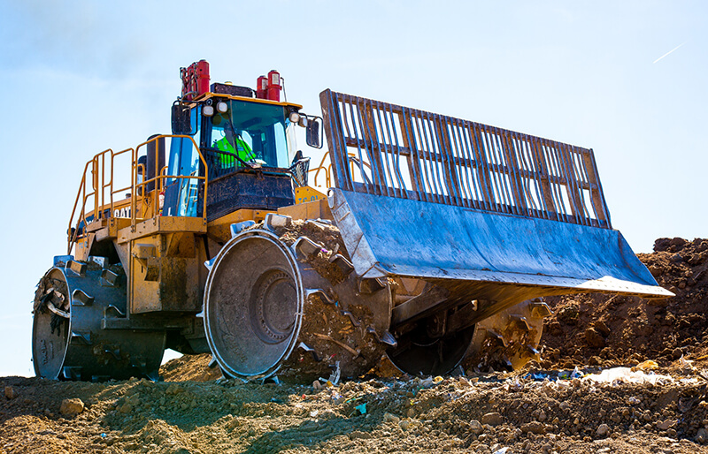 Picture of a large bulldozer used by Champ Landfill in their daily operation.